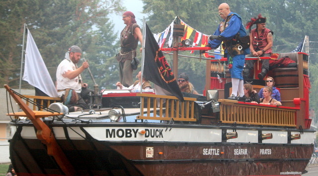 The Seafair Pirates prepare gunpower for another blast from the cannon.
