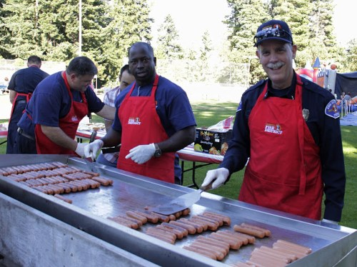 Plenty of hot dogs were on the grill for Tuesday's National Night Out event at the Evergreen Playfield. (Photos by David Carlos)