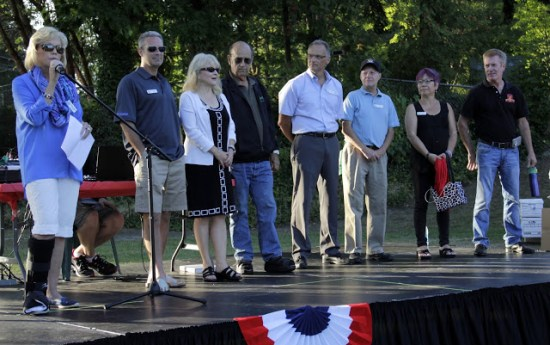 Mountlake Terrace City Manager Arlene Fisher (left) and members of the City Council welcome residents to National Night Out.