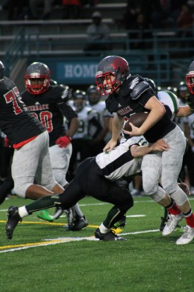 Mountlake Terrace senior Riley Morrin sheds a tackle attempt by Charger Michael Stewart. (Photo by Doug Petrowski)