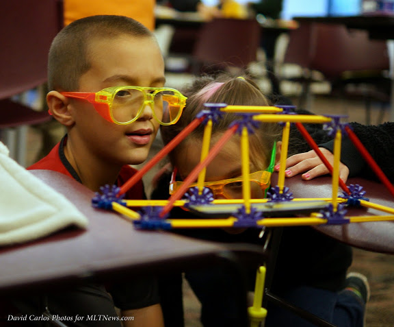 Children stress-test the limits of a bridge using K'Nex at the Mountlake Terrace Library Saturday. Safety glasses are required to protect eyes. (Photos by David Carlos)