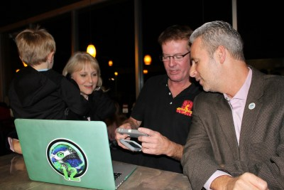 From left, Mountlake Terrace City Councilmembers Laura Sonmore, Seaun Richards and Bryan Wahl check on vote totals from Tuesday's general election during a gathering at Red Onion Burgers. (Photo by Doug Petrowski)