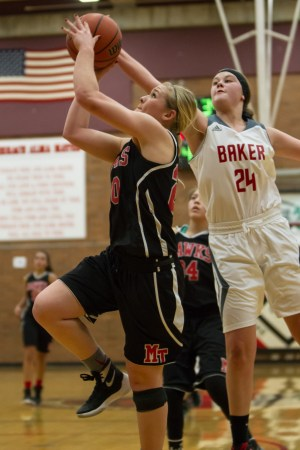 Hawk Jazz Zenk (left) gets her shot blocked by Mountaineer McKenzie Yost during Wednesday's action at the Mountlake Terrace Holiday Tournament. (Photo by Jonah Wallace)