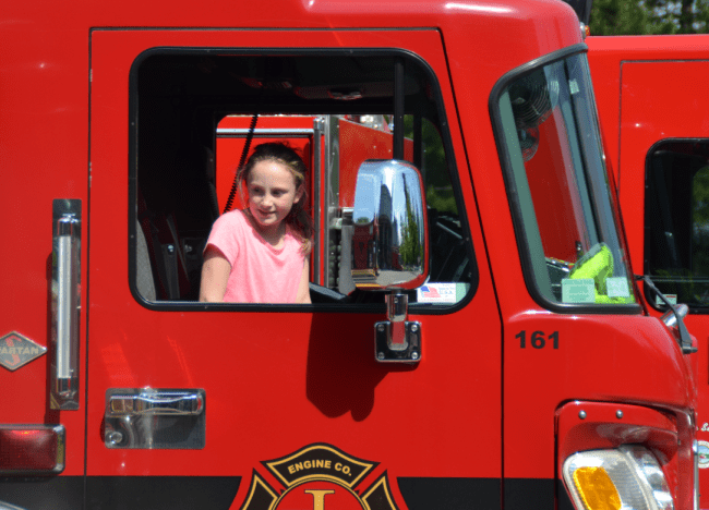 Kylie Morgan sits in a firetruck.