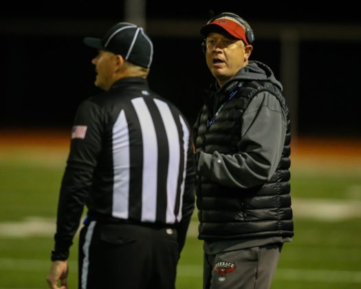 Coach Kelly Dougan has a discussioon with the referee about a penalty called against Terrace