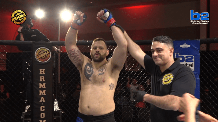 Harry Hunsucker gets his arm raised in the HR MMA cage.
