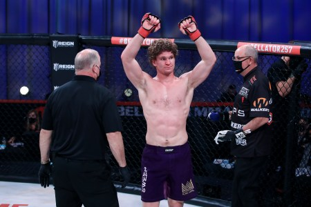 Karl Albrektsson raises his arms after a fight in the Bellator cage.