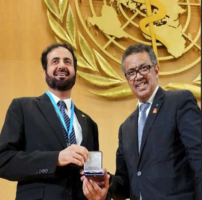 H. E. Dr. Tawfig AlRabiah, Minister of Health, receiving the 'WHO Tobacco Control Medal' from Dr. Tedros Ghebreyesus, Director-General, WHO.