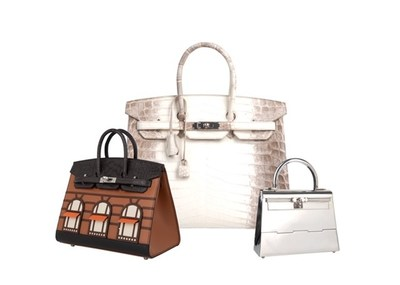 Three of the rarest Hermes handbags ever created, including the Kelly Mini in Sterling Silver, Birkin in Himalayan White Crocodile, and a Birkin bag modeled after Hermes' famous Paris flagship store. To be sold at auction by Greenwich Luxury Auctions, March 5, 2020.