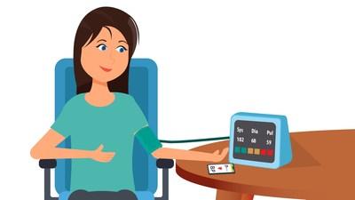 Woman monitoring blood pressure