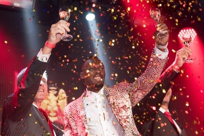 Usain Bolt celebrating the launch of Mumm Grand Cordon in Tokyo (PRNewsfoto/Maison Mumm)