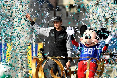 """Philadelphia Eagles quarterback Nick Foles stars in a celebratory Super Bowl parade Monday, Feb. 5, 2018, at Magic Kingdom in Lake Buena Vista, Fla., before throngs of cheering Eagles fans. Balloons and a blizzard of confetti in the Eagles' team colors completed the happy scene. Sunday night, after helping lead his Philadelphia Eagles to victory, quarterback Nick Foles turned to the cameras and shouted five famous words etched in sports lore: """"I'm going to Disney World!� Foles' visit to Disney World continues a Disney Parks tradition that began 31 years ago, in 1987. (David Roark, photographer)"""