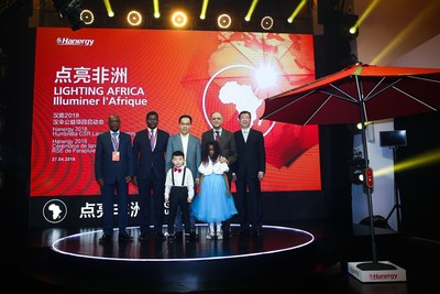 Founder of Hanergy Li Hejun takes a group picture with NGO representative and African Ambassadors
