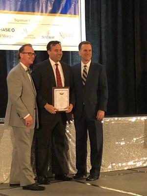 Joshua Rubin (center), Sevatec Chief Growth Officer, accepts Fantastic 50 Award