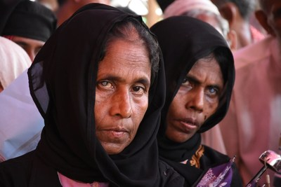 Two Rohingya women with cataracts wait for an eye test at the Orbis vision centre (PRNewsfoto/Orbis)