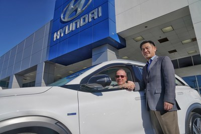 Yong-woo (William) Lee, president and CEO of Hyundai Motor North America, congratulates Todd Hochrad of Ventura, Calif., the first customer to receive the all-new Hyundai Nexo. Nexo is the only mass-produced fuel cell SUV for the U.S. market, boasting a range up to 380 miles.