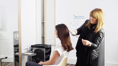 Henkel Beauty Care's Schwarzkopf Professional SalonLab Smart Analyzer in use.