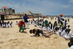 Pro-MMA fighter grapples in the sand in a NOGI BJJ and graplling demo during a MMA exhibition in Africa