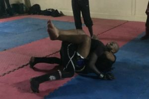 Pro-mma fighter shows a bjj choke to class in Africa