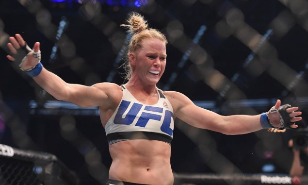 Nov 15, 2015; Melbourne, Australia; Holly Holm (blue gloves) celebrates after defeating Ronda Rousey (not pictured) during UFC 193 at Etihad Stadium. Mandatory Credit: Matt Roberts-USA TODAY Sports ORG XMIT: USATSI-256554 ORIG FILE ID: 20151114_jel_rb8_084.jpg