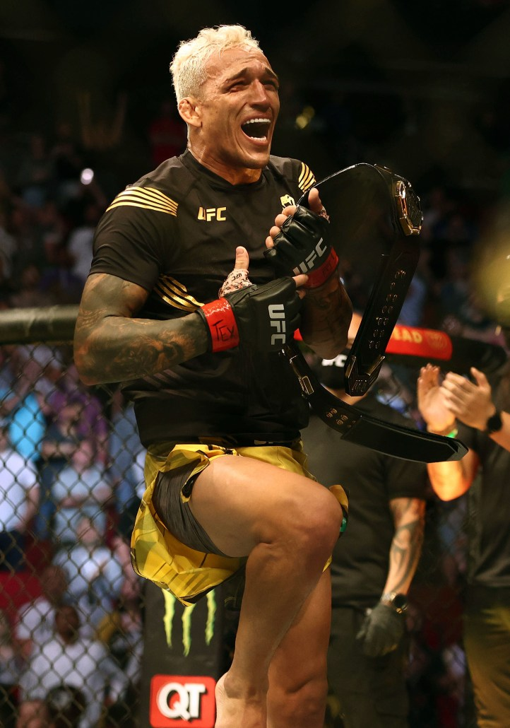 Charles Oliveira reacts to 'complete madness' of hero's meet in Brazil after UFC 262 title win. Video