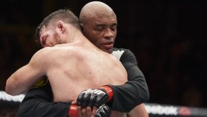 Anderson Silva and Michael Bisping embrace following their dramatic battle.