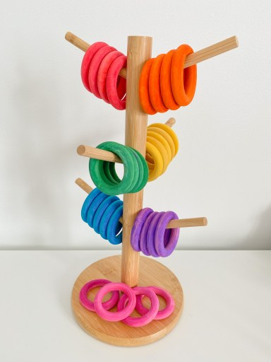 Here is a mug tree that is being used for sorting wooden rings. The rings were dyed using liquid watercolour.