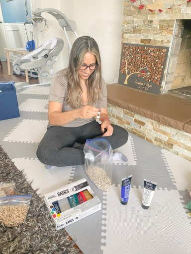 dyeing sensory filler using paint and hand sanitizer. In this step, you need to add the sanitizer and the paint.