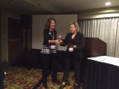 Angela Powers from Kansas State University receives the Barry Sherman Teaching Award from past head of the MMEE division, Bozena Mierzejewska.