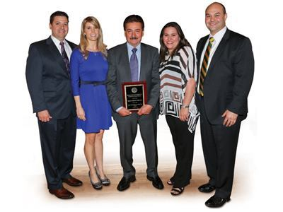 Edgar Sanchez, COO; his wife Julie; Cesareo Sanchez, president; Karla (Sanchez) Escobar, director human resources; Al Escobar, sales/marketing manager.