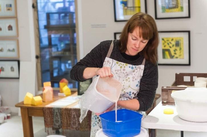 Pouring glaze through a small sieve