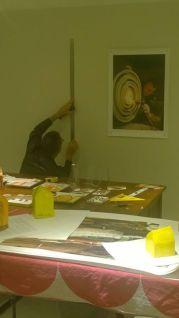 Tony working hard to hang his beautiful photos