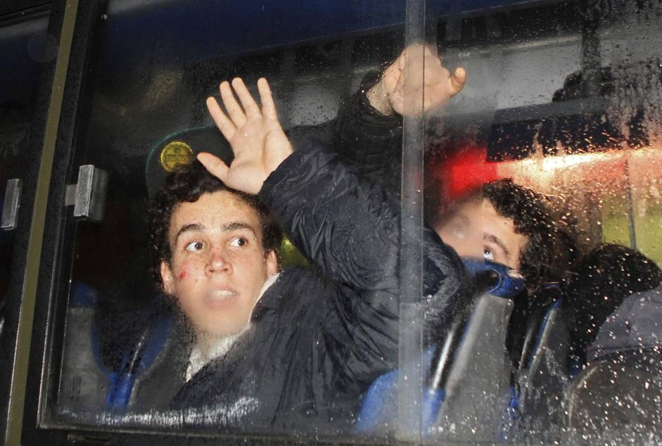 Demonstrators sit in a police bus after being arrested in an anti-government protest in Porto Alegre