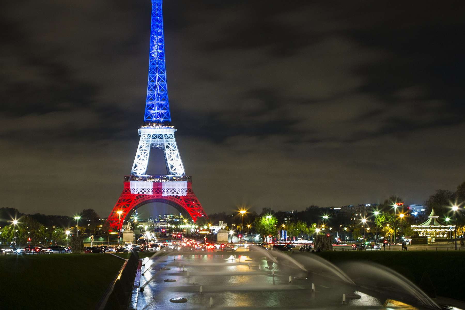 Eiffel Tower lit up blue, white and red to honor victims of Paris attacks