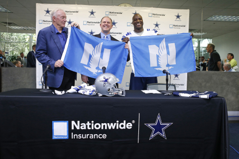 Nationwide Insurance chief marketing officer Matt Jauchius presents Dallas Cowboys owner and general ...