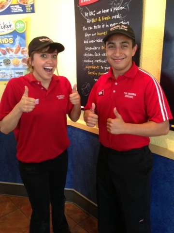 KFC team members Victoria Rodriguez and Michael Escobar give four enthusiastic thumbs up after learn ...