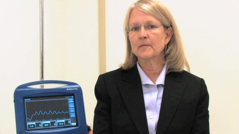 CEO and founder, Jenny Freeman, M.D., with the ExSpiron 1Xi Non-Invasive Minute Ventilation Monitor. ...