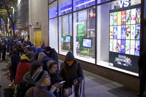 In this photo provided by Nintendo of America, fans wait in line at Nintendo World in New York on No ...