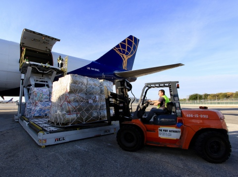 JetBlue and Atlas Air crewmembers load a 747 aircraft with more than 110 tons of supplies to assist ...