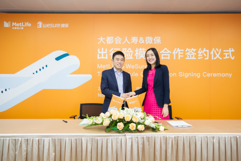WeSure Chairman, Alan Lau and Siyi Sun, CEO of MetLife China. (Photo: Business Wire)