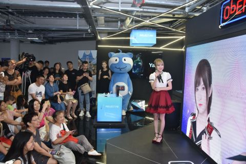 Aijia from SNH48 interacting with her Personal AI (PAI) at the Shanghai World AI Conference (Photo:  ...