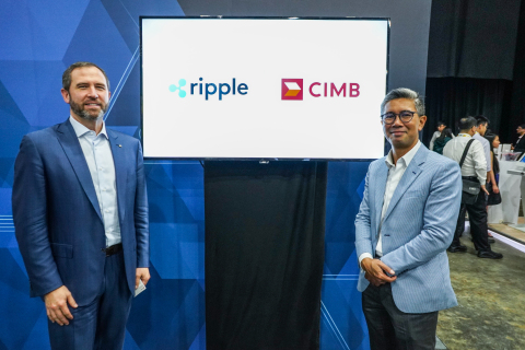 Ripple's CEO Brad Garlinghouse and CIMB Group's CEO Tengku Dato' Sri Zafrul Aziz celebrate their par ...