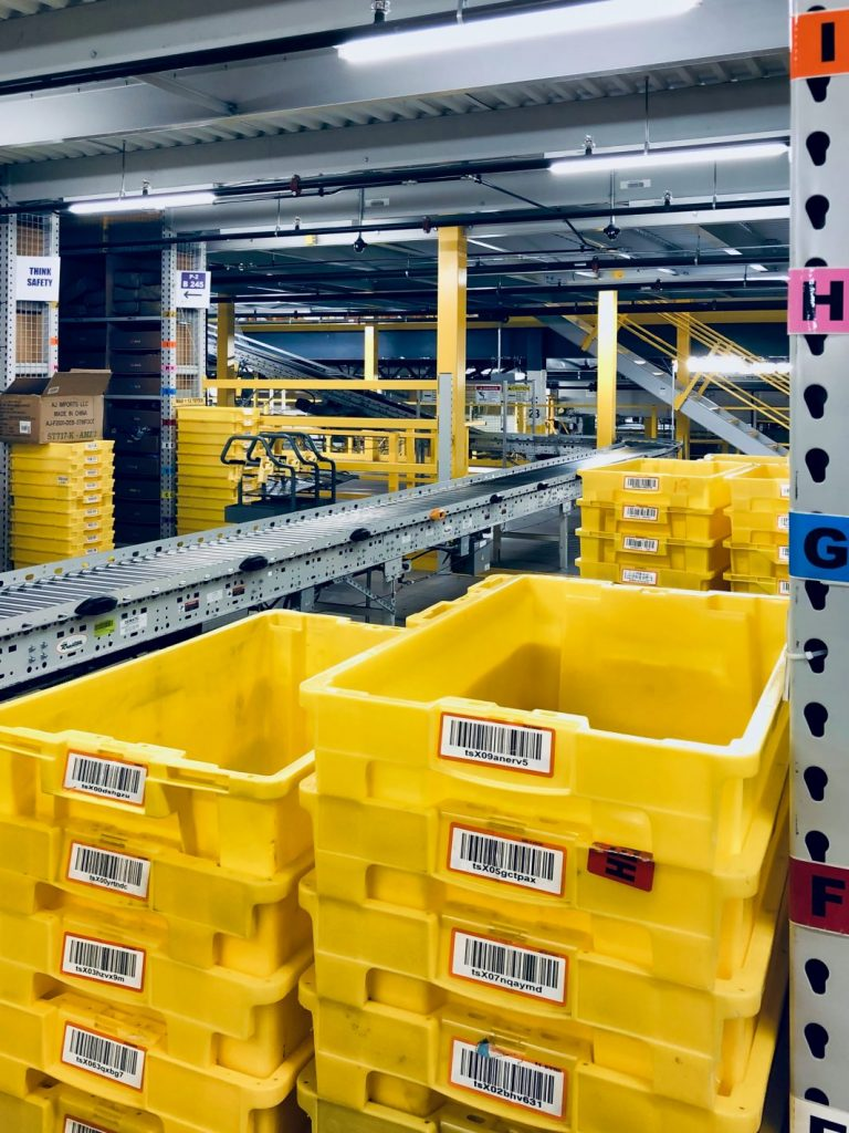 amazon yellow totes and conveyors