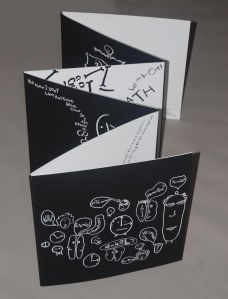 """White on black Black on white panels """" A Converation about Death"""" accordion book. One of two books featured in my MFA thesis."""
