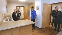 t11.15.17 Bob King -- 111617.N.DNT.GATEWAYc2 -- Visitors to the Gateway Tower Apartments take a look around one of the apartments. Bob King / rking@duluthnews.com