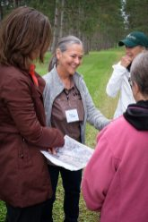 Land Trust staff member helping guests