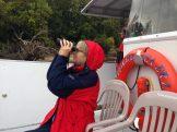 Ann & binocs on boat