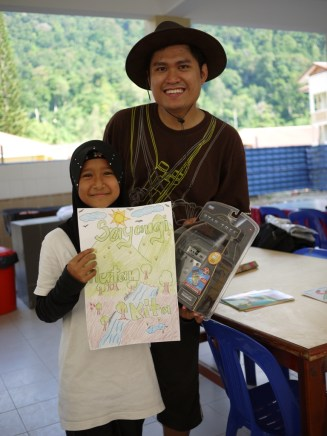 Ilyas with the 1st prize art winner