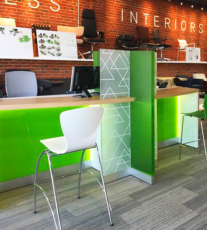 Bright green back-painted glass reception space