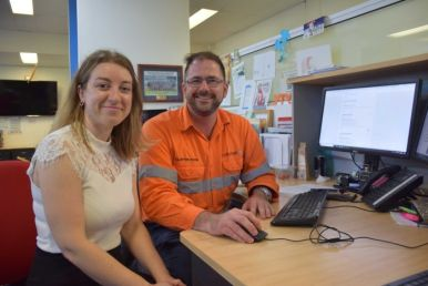 Townsville jobseeker Marina Stoianovski sitting at a desk with recruiter Clayton Cook.